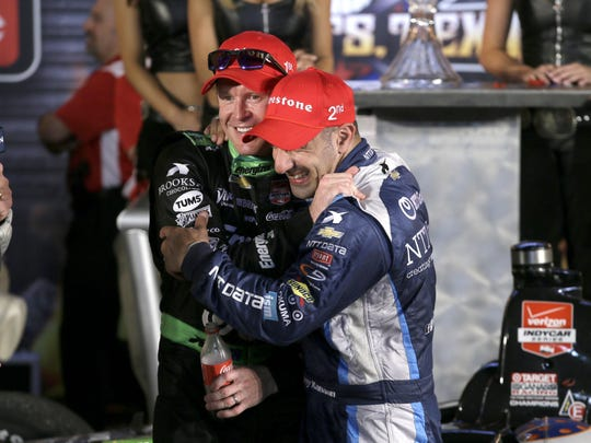 Tony Kanaan, front, of Brazil celebrates with Scott Dixon, left, after Dixon won the Firestone 600 IndyCar auto race at Texas Motor Speedway Saturday, June 6, 2015, in Fort Worth, Texas. (AP Photo/Tim Sharp)