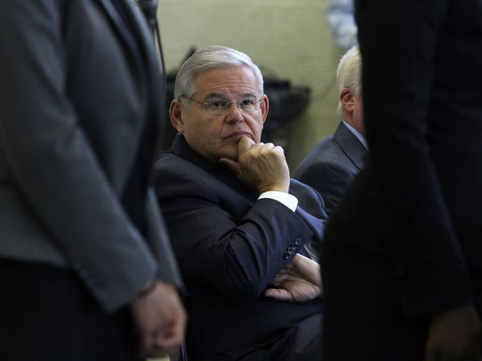 U.S. Senator Bob Menendez listens during a National Flood Insurance Program Claims Review Clinic, a clinic to help Sandy victims considering having their flood insurance claims reviewed, at Civic PLaza in Brick, NJ Monday June 15, 2015. Staff photo Tanya Breen ASB 0616 Flood insurance lawyers