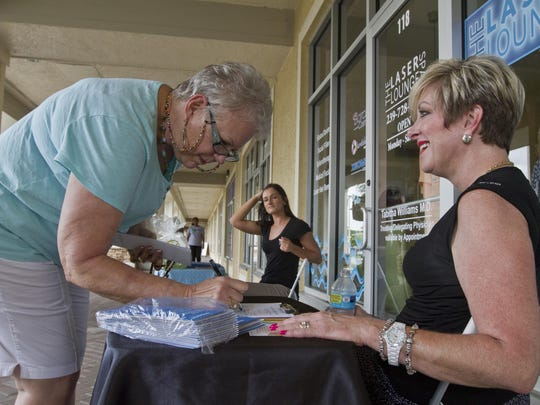 Beverly Rathburn, left, a resident of Verandah in Fort Myers, signs in for some promotional information on a recent Wednesday afternoon at the newly-opened The Laser Lounge at The Shops at Verandah. Kara Kridle, right, an employee for The Laser Lounge was providing assistance.