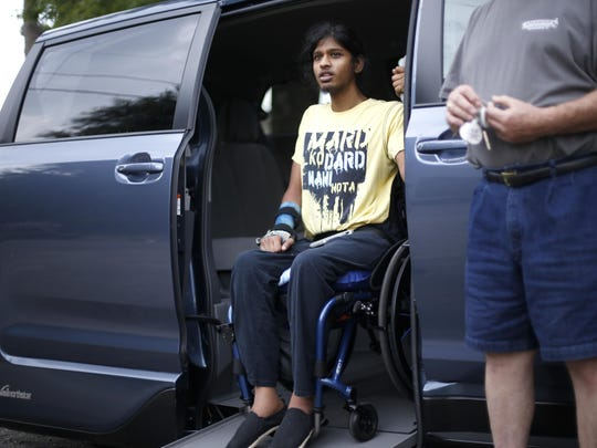 Ronny Ahmed sits in his newly modified van at Advanced Driving Systems on Monday.