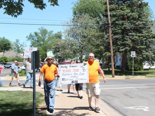 Keith Kitsembel, left, and Allen Rasmussen lead a protest around the Portage County Courthouse in June, 2014, against the county's decision to not issue marriage licenses to same-sex couples.