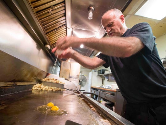 Mike Gragg cooks eggs at Arner's Restaurant in New Castle on Thursday.