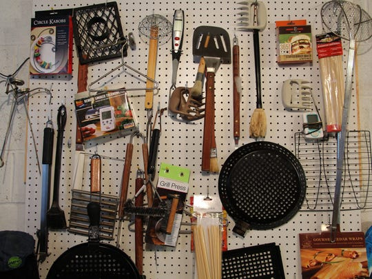 Mike Acken of Morristown keeps his grilling tools organized and easy to find on a pegboard in his basement.