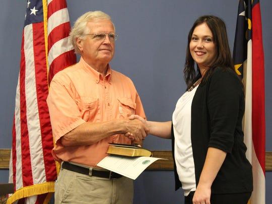 2015: Having sworn her in, Mayor Michael Sobol congratulates Angela Reece on her new job as town clerk.