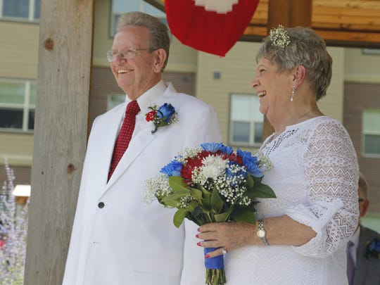 Ray Reierson, 84, and Doris DeBolt, 80, get married at Fort Des Moines Senior Housing Saturday, July 4, 2015.