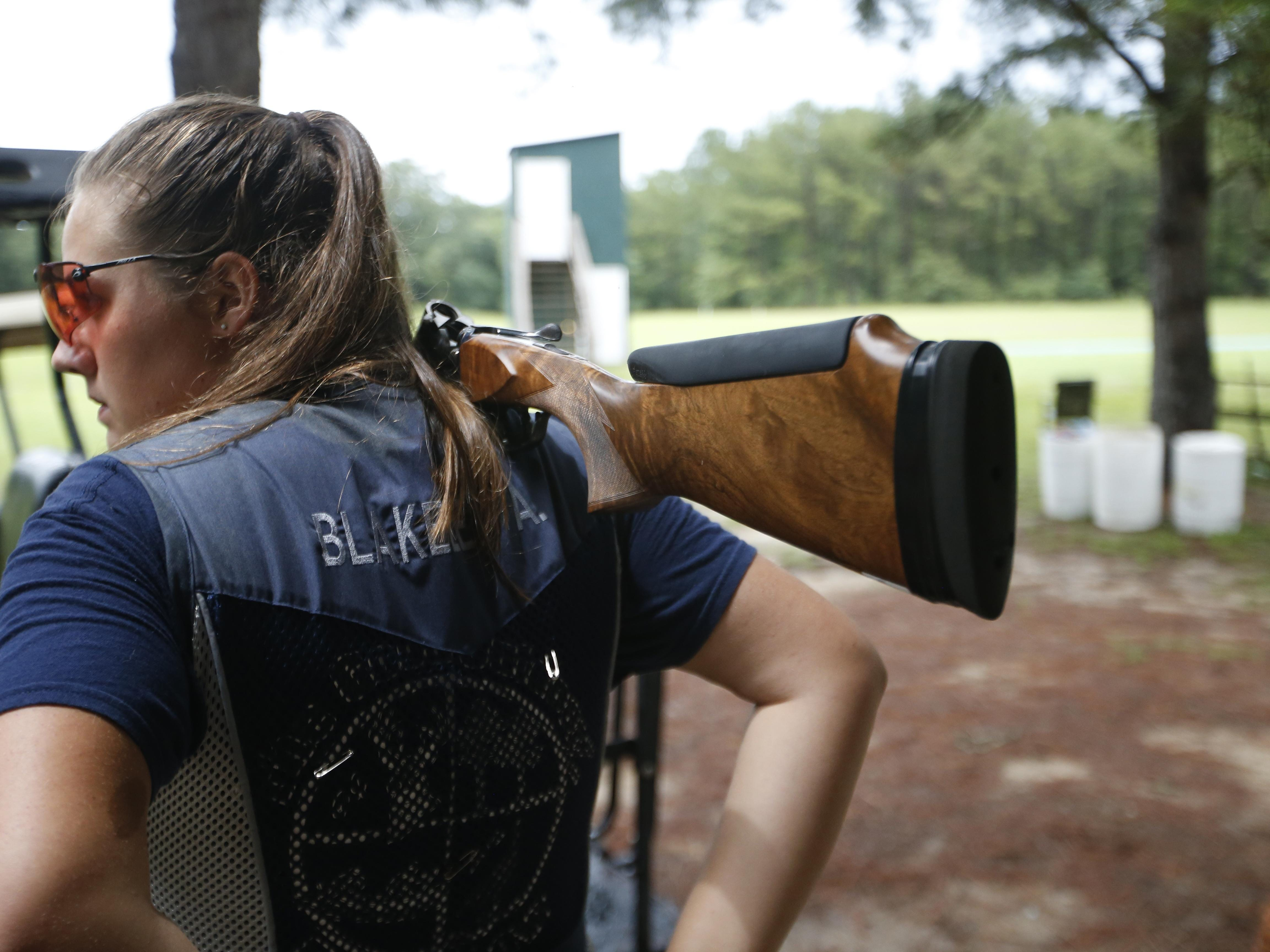 Abby Blakeley steps out on the clay pigeon shooting range at the Bridge Creek Clays South Georgia Youth Shooting Club on Tuesday, June 30, 2015.