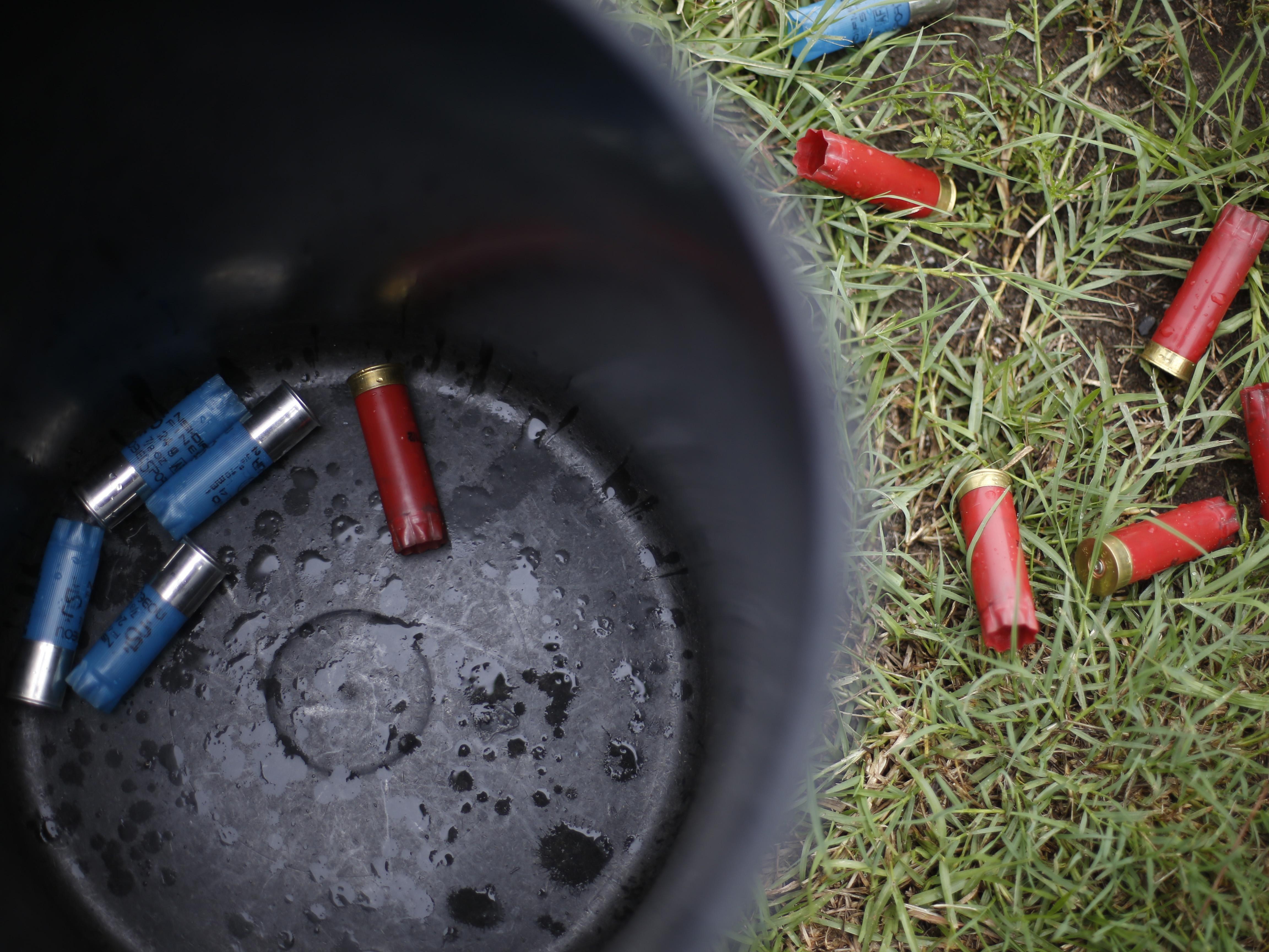 Empty shotgun shells litter the ground at Bridge Creek Clays South Georgia Youth Shooting Club's clay pigeon range on Tuesday, June 30, 2015.