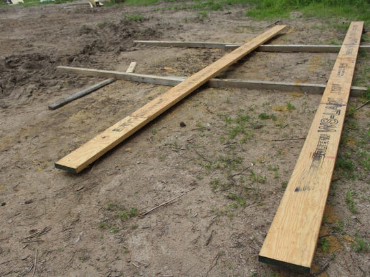 Planks of wood site at the spot a kitchen garden — which will grow organic fruits, vegetables and herbs— will ultimately be planted.