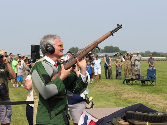 U.S. Rep. Bob Latta, R-Bowling Green, prepares to fire the traditional first shot of the National Matches at Camp Perry.