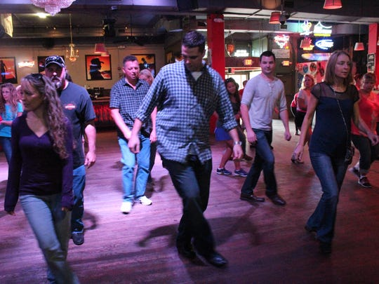 Line dancing at Dixie Roadhouse in Cape Coral