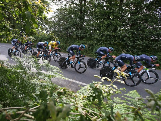 Team Sky with Britain's Christopher Froome, wearing the overall leader's yellow jersey,  rides to take a second place in the ninth stage of the Tour de France cycling race, a team time-trial over 28 kilometers (17.4 miles) with start in Vannes and finish in Plumelec, France, Sunday, July 12, 2015. (AP Photo/Peter Dejong)