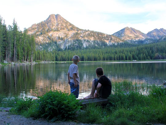 Rylan and Noah Peters look out at sunset on Anthony Lake in the Elkhorn Mountains of Eastern Oregon.