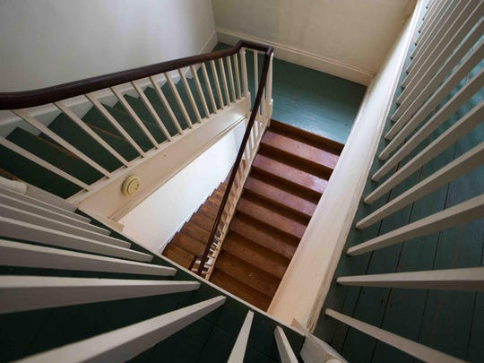 All three floors of the Kensey Johns House, with upper floors accessed by this winding staircase, will get paint, furnishings and other TLC from volunteers helping interior designer Barbara D. Pettinella of Hockessin transform the house for a fundraising gala and public tours in September as the Sunday Breakfast Mission of Wilmington lists the donated house for sale.