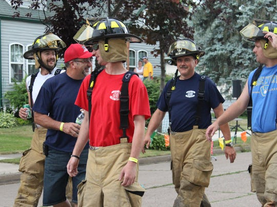 Colby firefighters walk toward the Colby Fire Department