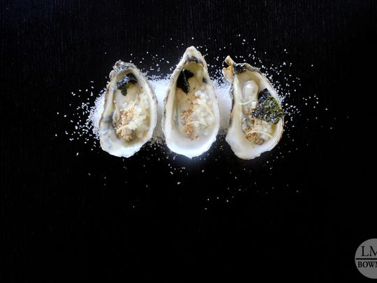 The oyster dish includes pickled kohlrabi, toasted sesame seeds and nori.