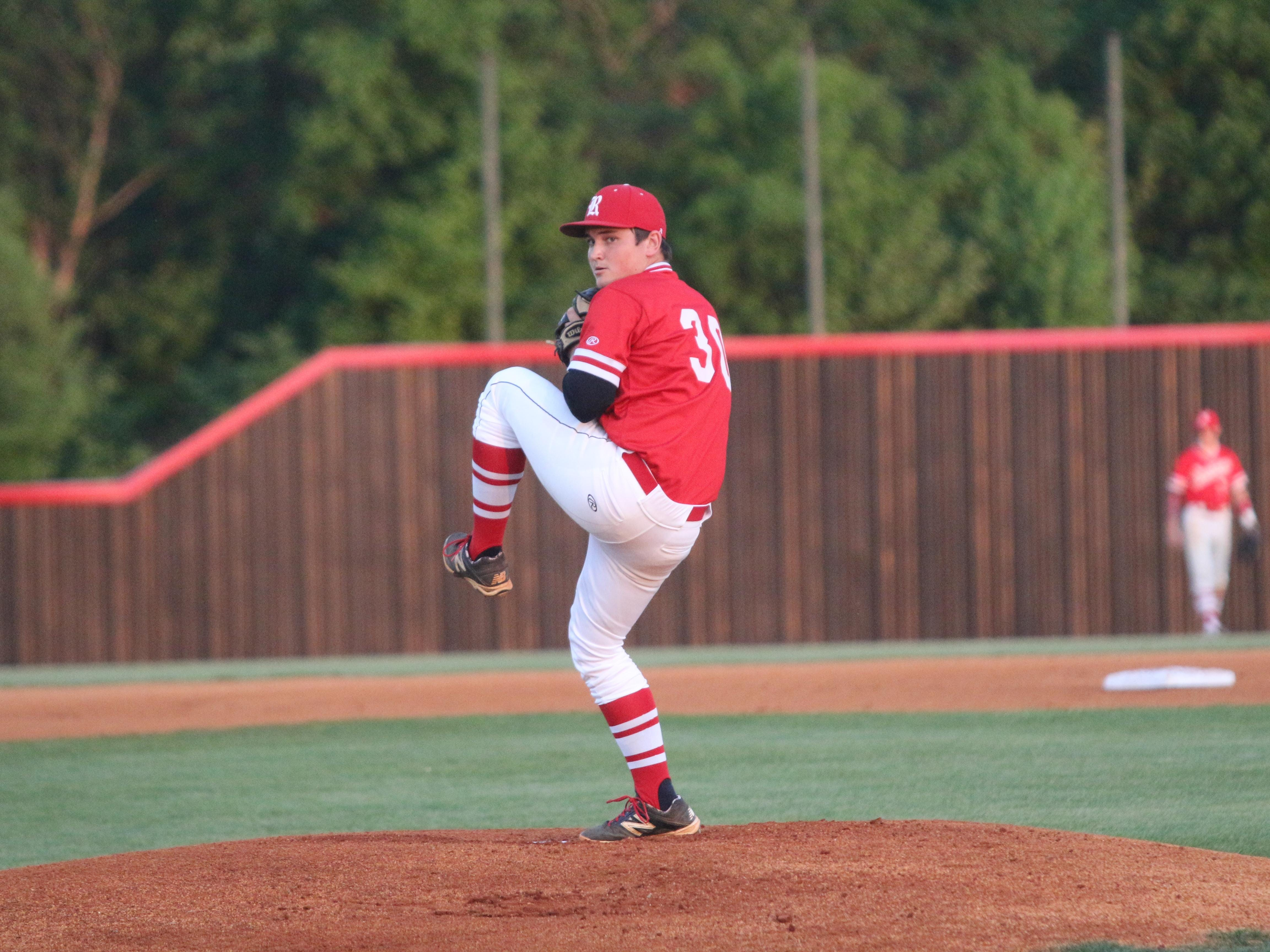 Rossview pitcher Blake Kiely sets to throw a pitch during the District 10 baseball tournament against Springfield two months ago.