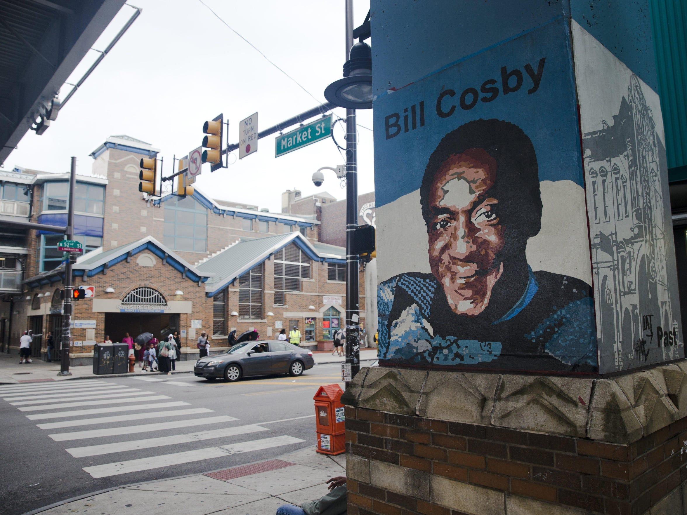 Shown is a mural depicting entertainer Bill Cosbyon