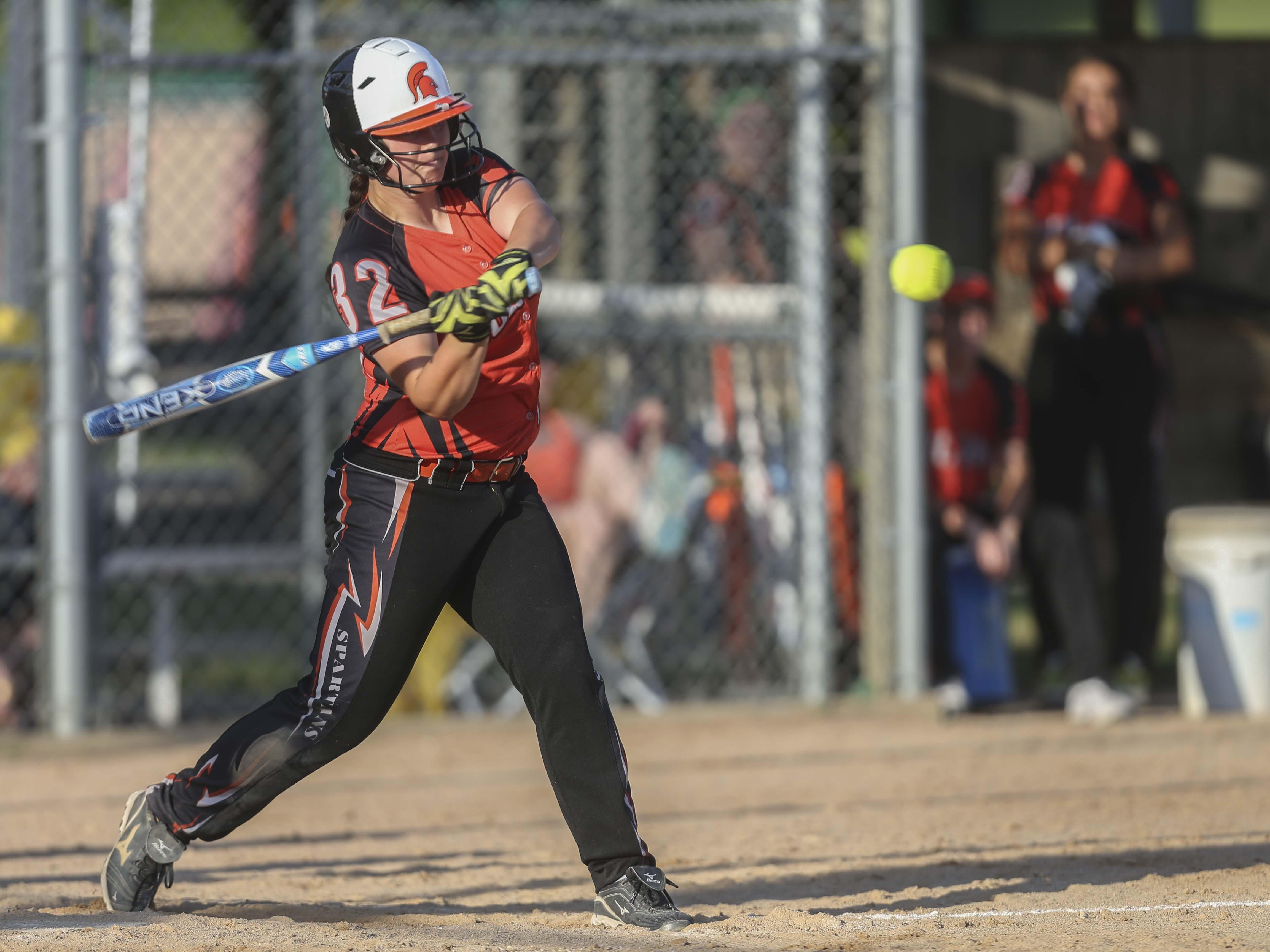 Solon's Lexi Stebral hits the ball during a softball doubleheader between Solon High School and Dyersville Beckman on Tuesday, June 9, 2015.