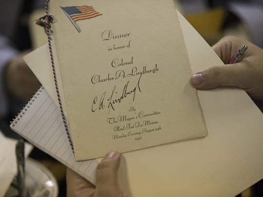 A program signed by Charles Lindbergh is on display