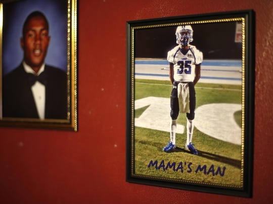 "A photo of Nick Doss with the words ""Mama's Man"" hangs on the wall at his mother Tori Hannah house, where they lived together. Dozens of photos, trophies and memorabilia from Doss' life line the walls of the home."