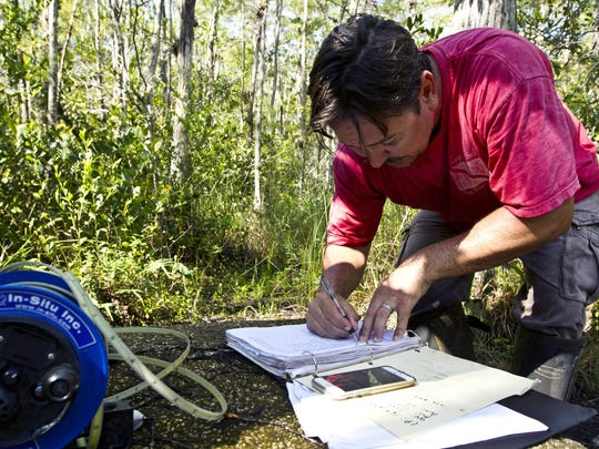 Annotations are taken by research hydrologist Barclay Shoemaker after working on a repair at one of the USGS weather monitoring towers at Big Cypress National Preserve off Loop Road.