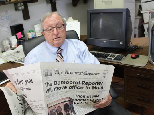 Democrat-Reporter Publisher Goodloe Sutton reviews an article about the paper moving to a new location.