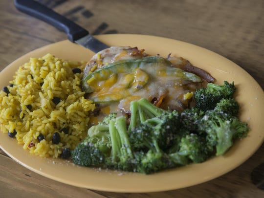 Beachside Chicken with yellow rice and broccoli at Hurricane Grill and Wings.