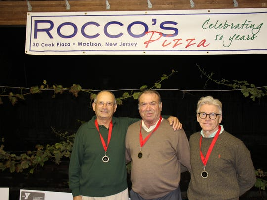 Pictured (from left to right) on the Bocce court are The Madison Area YMCA 2014 Charity Bocce Tournament Champs. The Forum Club Team members are Tony Caruso of Summit and Team Captain Rocco Iossa of Madison. Pictured with them is Madison Area YMCA Board member Ellsworth Havens of Florham Park.
