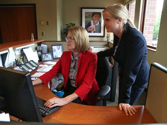 Missy Gray and Pam Culp at work at the Foster Group on Tuesday, Aug. 4, 2015, in West Des Moines.