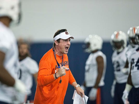 FILE - In this Aug. 4, 2015, file photo, Auburn's defensive coordinator Will Muschamp screams at a player during an NCAA college football practice in Auburn, Ala. There are 14 new coordinators around the league, including Muschamp at Auburn. (AP Photo/Brynn Anderson, File)