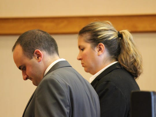 Prosecutor Joe Gerber and detective Amanda Cross, Ottawa County Sheriff's Office, in the trial of Chris Blessing.