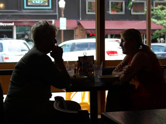 Customers finish up their meals at J. Gumbo's on Aug. 13.