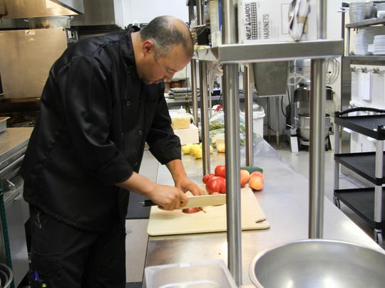 Willamette Valley Vineyard's new executive chef, DJ MacIntyre, works in the kitchen at the winery on Aug. 14.