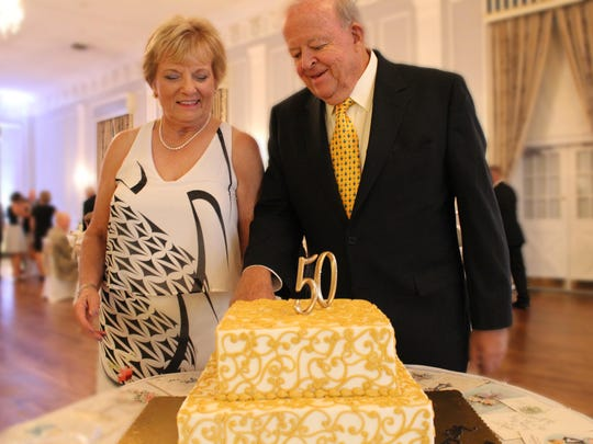Fred and Sheila (Lorenz) Osann of Wilmington, N.C., cut the cake at their 50th wedding anniversary party at the Mayflower Meeting House, also the site of their wedding.