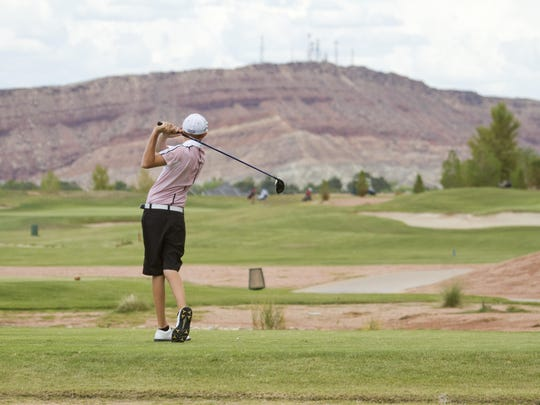 Noah Schone, from Pine View, tees off at Sun River, Thursday, Aug. 21, 2014.