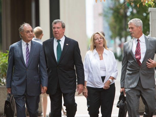 Former Wilmington Trust President Robert Harra Jr. (second from left) arrives Thursday at the the federal courthouse in Wilmington for his arraignment on charges he hid past-due loans from regulators. He is accompanied by his wife, Linda, and lawyers Michael Kelly (far right) and Andrew Lawler (far left).