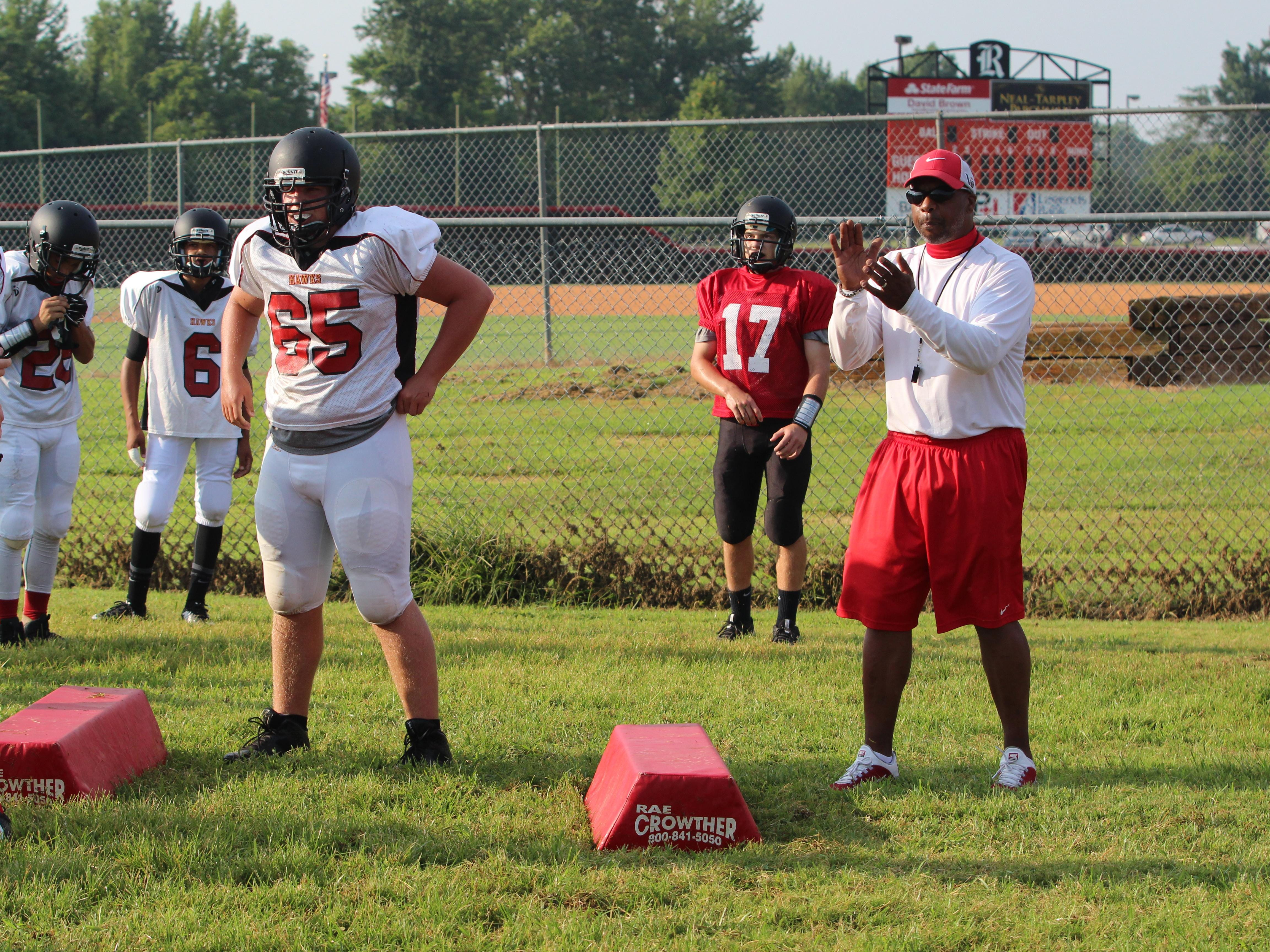 Rossview coach Ron Lambert (right) encourages his team as they compete during the first official day of football practice last month.