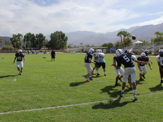 The Desert Chapel football team scrimmages during practice Tuesday, September 1, leading up to the team's first game of the season on Friday.