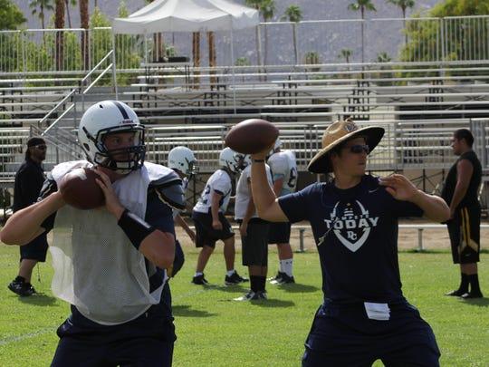 Senior Desert Chapel quarterback Kaleb Whan and head coach Jim Donaldson throw passes during an offensive drill during practice Tuesday, September 1.