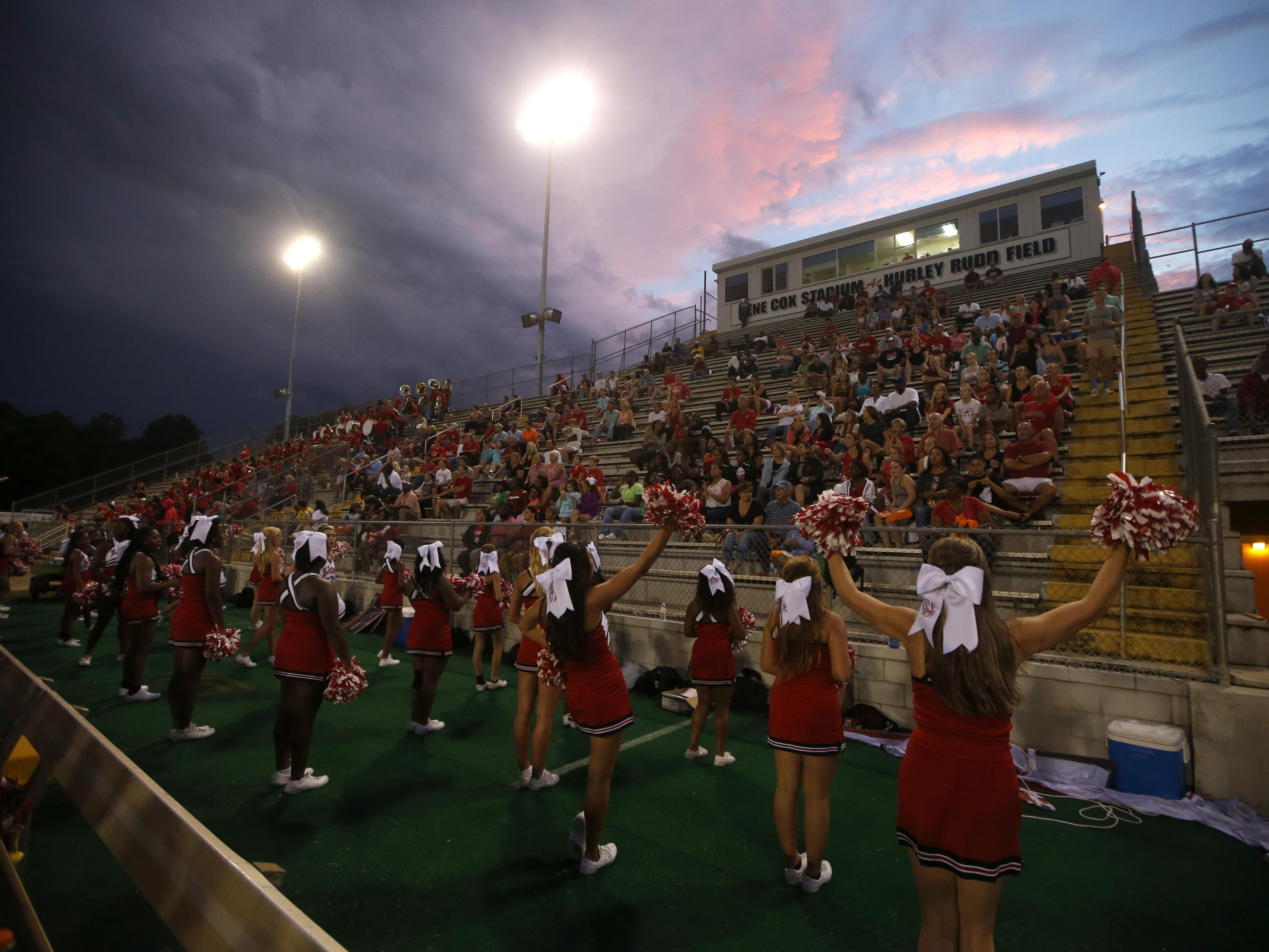 Leon's cheerleaders perform for the crowd during their game against Suwannee at Cox Stadium.