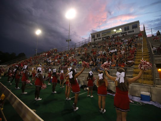 Leon's cheerleaders perform for the crowd during their game against Suwannee at Cox Stadium on Friday.