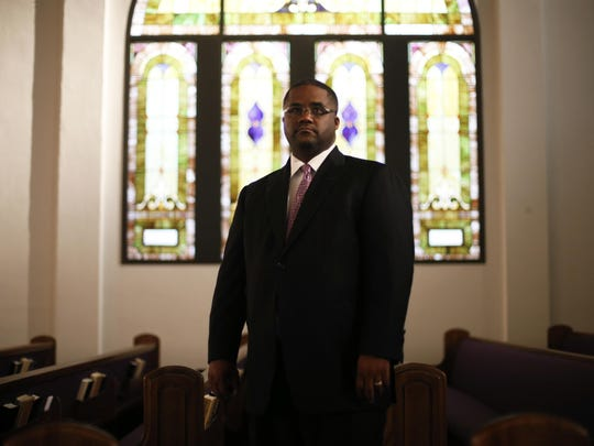 Rev. Julius McAllister stands in Bethel AME Church's main worship room Thursday. The church is preparing to celebrate the 150th Anniversary of the Florida Annual Conference this month.