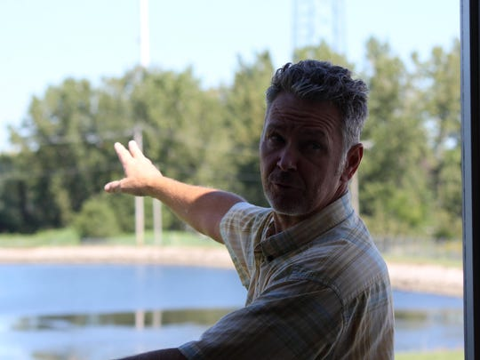 Ron Wetzel, superintendent of the Ottawa County Regional Water Treatment Plant, describes the purpose of the two sludge and backwash lagoons.