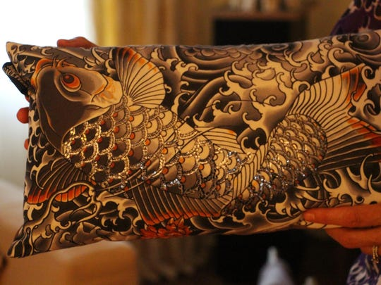 A pillow with a textured fish design by Jean Paul Gaultier.