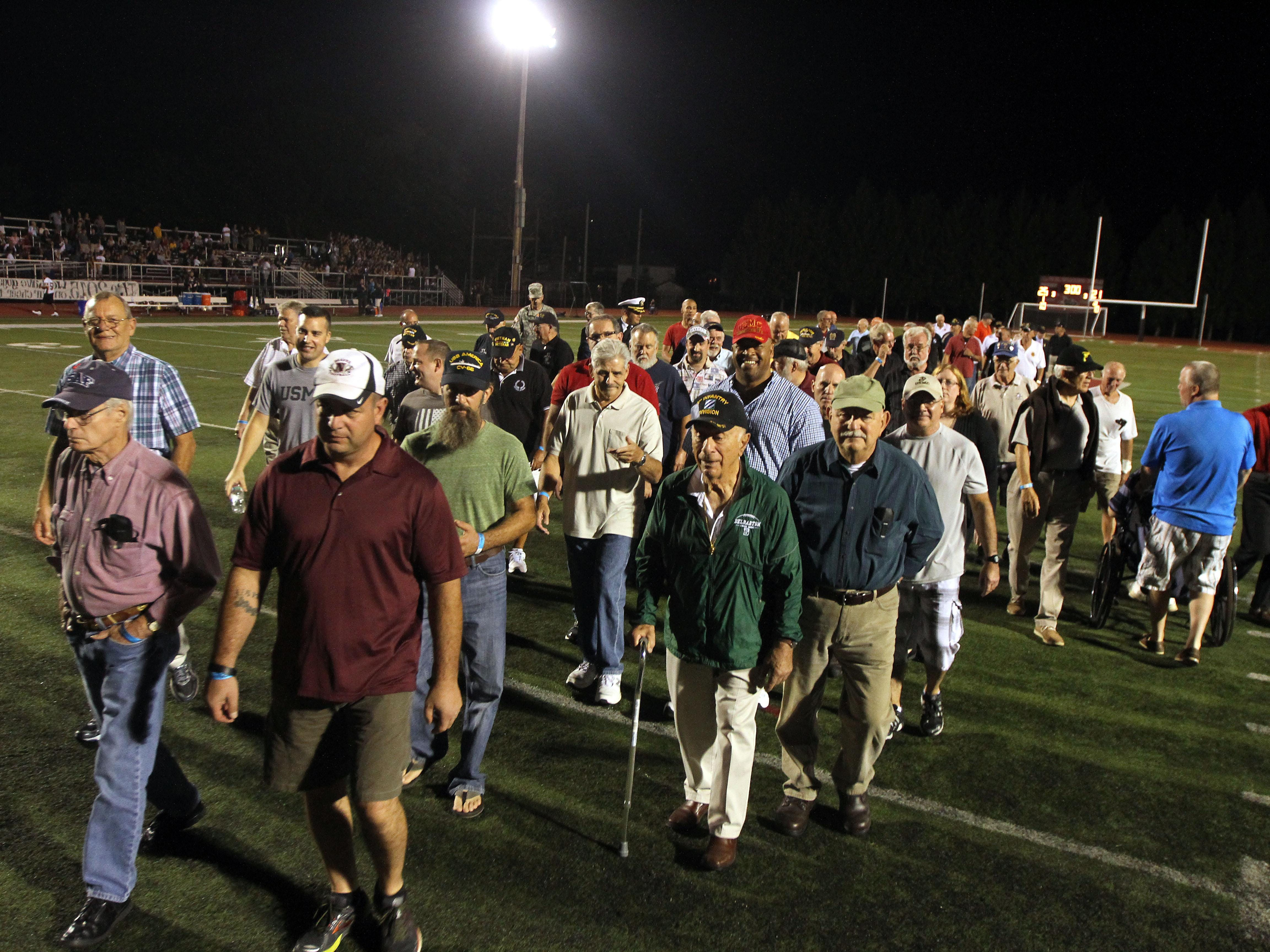 Boonton High School honored its graduate military veterans during halftime of the Boonton High School football game Friday night. The vets, some of whom are still residents, others coming back from out of town, also enjoyed a tailgate party prior to the game and ceremony. September 18, 2015, Boonton, NJ.