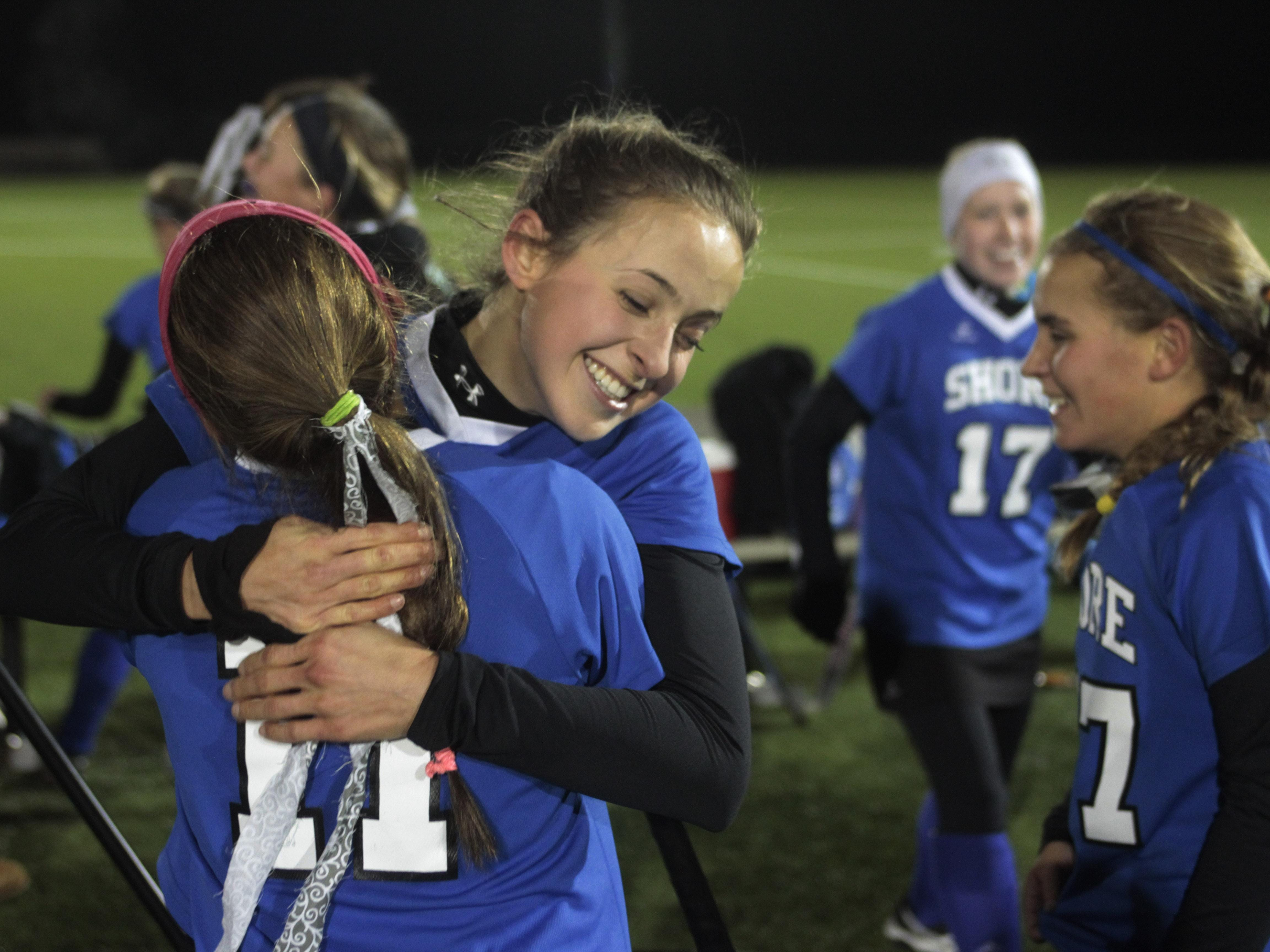 Annie Deusch gets a hug from team mate Veronica Goldberg (facing camera) as they celebtate their group 1 title. Shore Regional vs Collingswood NJSIAA Field Hockey Group I Finals in Bordentown, NJ on November 145, 2014. Peter Ackerman /Staff Photographer