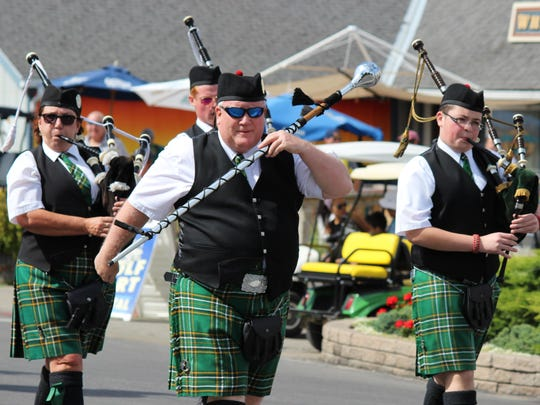 The West Side Irish American Club Pipe Band leads the parade celebrating Put-in-Bay's 14th annual Halfway to St. Patty's Day.