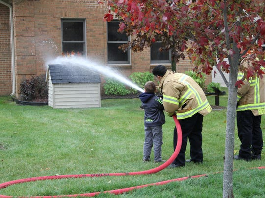 Children got to spray fire hoses during the open house.