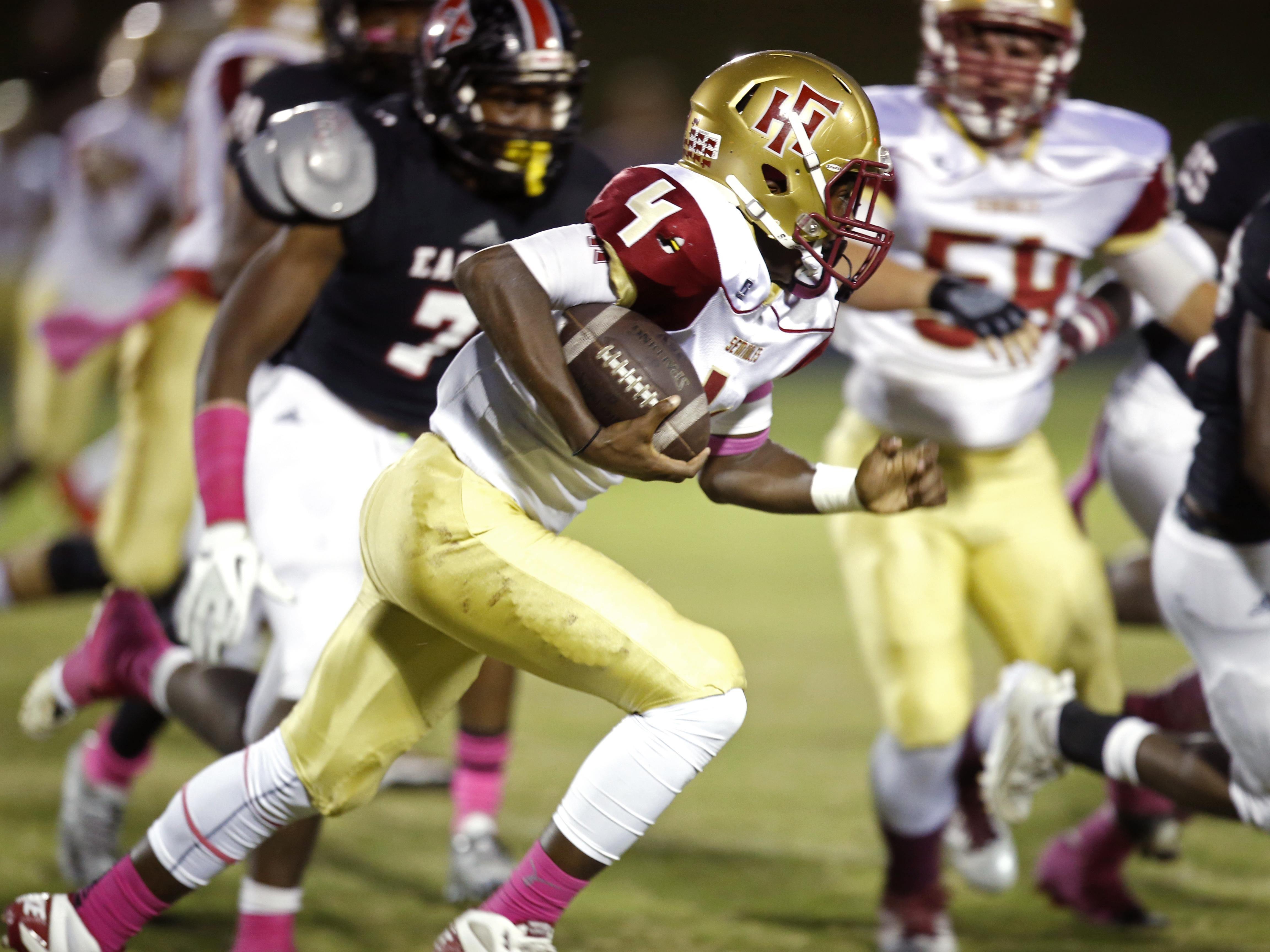 Florida High's Kevin Sawyer Jr. runs the ball against NFC during their game on Friday.