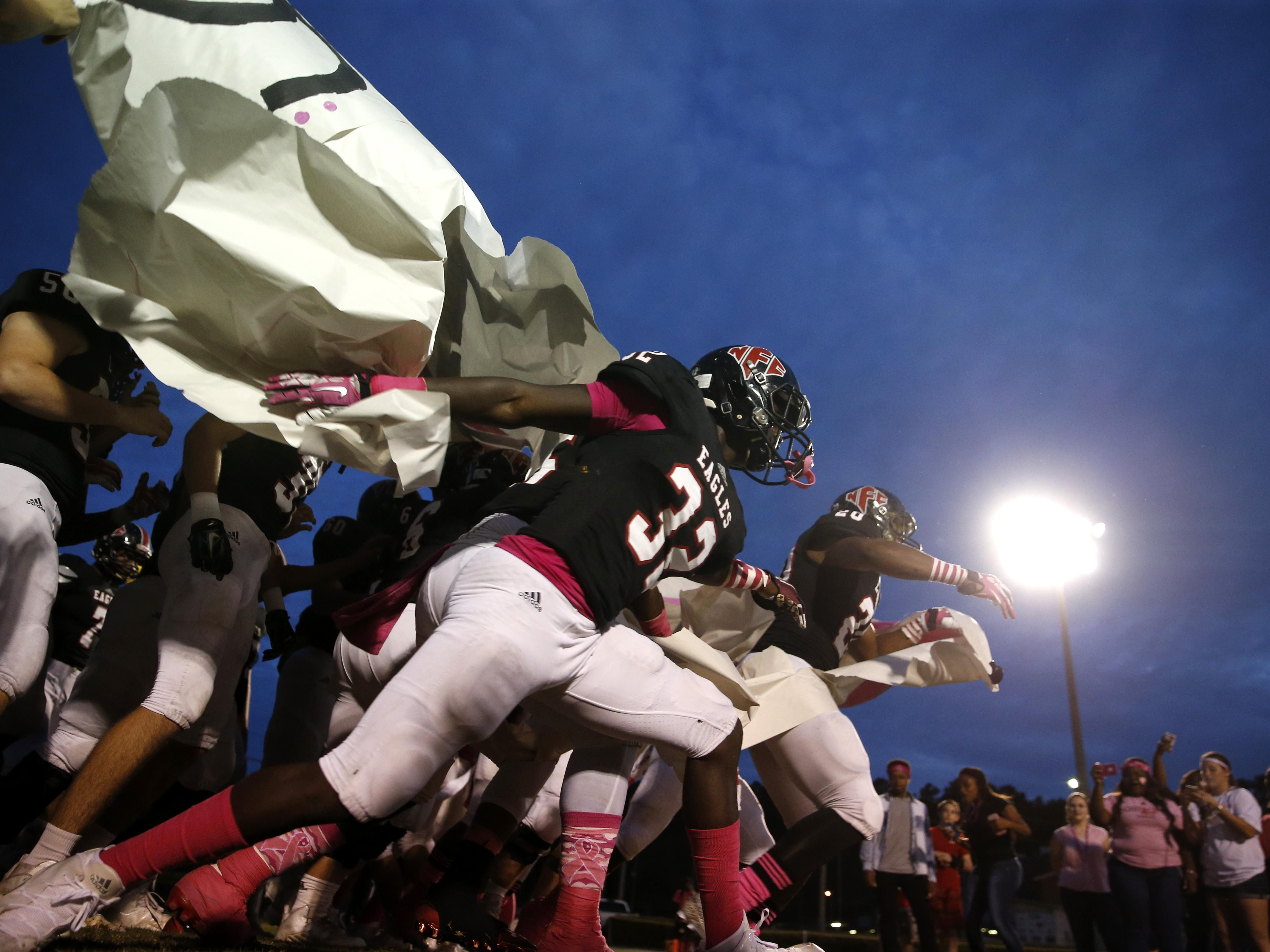 The NFC Eagles burst out on to their home field to play against Florida High on Friday.